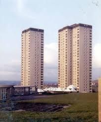 Cottingley, Leeds. Towerblocks with modernist shopping centre and pub.