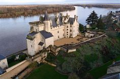 The Château de Montsoreau is in Montsoreau, Maine-et-Loire, France. Constructed in 1455 by Jean de Chambes, a senior councillor to King Charles VII. It was a strategic fortress, controlling river traffic between Chinon and Saumur. The castle has an exceptional position at the confluence of two rivers, the Loire and the Vienne, and at the junction of three historic regions: Anjou, Poitou and Touraine. Unlike other castles by the Loire, Montsoreau was directly built in the river.