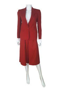 "A wonderful skirt suit from Christian Dior featuring a single breasted jacket and calf length skirt. Jacket Shoulder 15""   Sleeve 22""   Bust 18""   Waist 17""   Full Length 26"". The skirt has an elasticated waist.   eBay!"