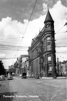 CCT0010 - Looking west to the Gooderham (Flatiron) Building at Front Street East, Wellington Street East and Church Street. Toronto, Ontario c1947