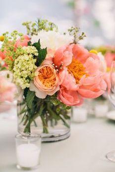 Peach floral centerpiece; peonies, roses, babies breath