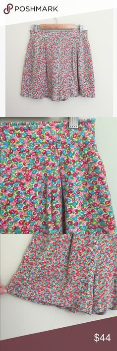 "Lilly Pulitzer Lollipop Swirl Pique Bloomer Shorts Adorable and rare Lilly Pulitzer shorts. Elastic waist with pleating. Spiral lollipop candy print with Lilly monogram throughout. Size petite small. 15"" long, 26"" waist, 11"" rise, 4"" inseam. Measurements approximate. No trades, offers welcome! Lilly Pulitzer Shorts"