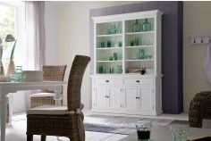 The beautiful Halifax Halifax White Painted Hutch Bookcase Unit will store and display plenty. Attractive wainscoting provides a subtle New England style backdrop to the upper open shelving unit. The base units feature shaker style doors with black hardware. Moulding and decorative trim are further enhanced by the semi-gloss white paint.