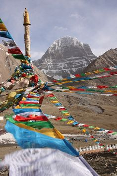 Prayer flags leading towards Mt. Kailashs unbroken north face - Tibet