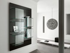 A modern Italian glass and lacquer bookcase By:  Dazibao