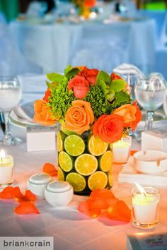 Tropical centerpiece using bright flowers and fruit. #ElDoradoRoyale #Mexico #destinationwedding