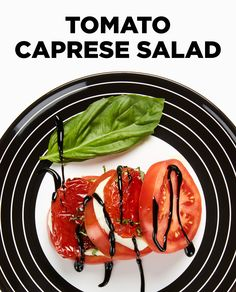 Tomato Caprese Salad is a high stack of oven-roasted tomatoes, plum ...