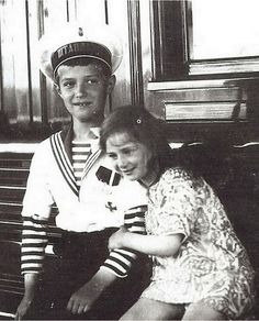 Princess Ileana with Czarevich Alexei, another great-grandchild of Queen Victoria, during the Imperial family's visit to Romania. Ileana seems quite taken with him!