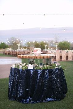 What a beautiful way to dress up your cake table! This navy sequin linen comes in many different colors. Call today for options and availability! 937-885-5454 http://www.asplayzone.com/wedding-rentals/