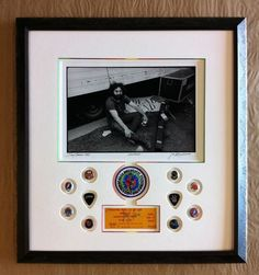 Jerry Garcia photo with GD guitar pics, a patch and ticket.  The inner bevel was painted in a rainbow fade.