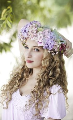 flower crown. Love the curly long bridal hair with or without the flowers.