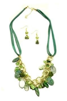 """A collection of coordinating elements make this necklace a great find! We started with a double teal suede cord, added gold tone chain, beads and clasps, then assorted shapes of natural shell beads. To this we added Swarovski crystals and glass pearls in shades of green.    Measurements: earrings;1.5""""with French hooks; Necklace;22"""".   Teal/green Necklace Set by Mimi's Gift Gallery. Accessories - Jewelry - Earrings - Statement Accessories - Jewelry - Necklaces - Statement Necklaces…"""