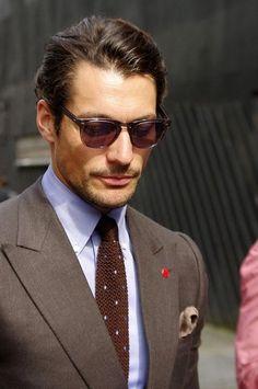 brown suit, peak lapels.                                                                                                                                                                                 Plus
