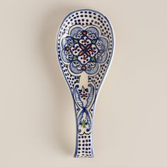Our exclusive Tunis Spoon Rest features a unique design inspired by the traditional Tunisian artwork found throughout Northern Africa and Moorish Spain. Place used cooking spoons on this hand-painted ceramic rest to prevent countertop messes.