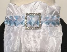Euro style. The crinkle taffeta fabric is special to look at and to wear. The ultralight weight is super for hot weather. Easy care fabric which maintains shape after cleaning. Braided center piece is pale blue satin with organza stripe combined with white satin. Square clear rhinestone slider set in silver.
