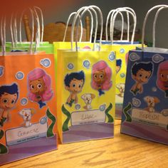 Bubble Guppies Birthday Bags - cheap Dollar Tree bags and stickers. Super easy!