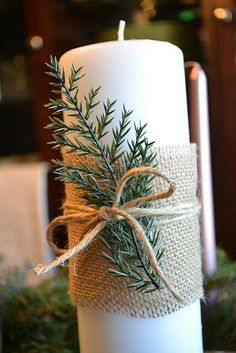 Burlap, string and an evergreen sprig wrapped around this candle creates a warm and homespun centerpiece.