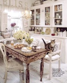 I don't think I could have this as my kitchen, but it's totally adorable.  Love the coziness the cat adds to the picture.