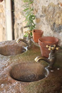 THESE are the type of 'vintage' taps i want for my home!!  basins from natural stone, wow!  :)