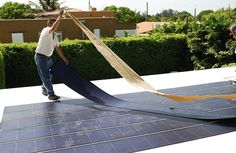 thin film solar - As easy as peel and stick. (And then attach connectors.) Efficiency is improved if film is slanted toward sun. Final installation and layout of Uni-Solar Ovonic's thin Film Flexible Solar PV panels. Image: Fieldsken Ken Fields. Video of a panel lying flat on a deck: youtube.com