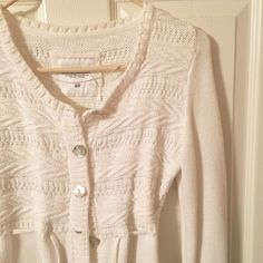 White H&M Sweater Women's knit white L.O.G.G. Brand from H&M sweater/cardigan. Has mother of pearl looking buttons and tie around waist. Warm and comfortable. Only warn once and in excellent condition. No trades. H&M Sweaters Cardigans