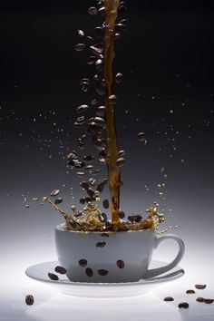 Coffee and Coffee Beans Splash. by BrianEnright from http://500px.com/photo/212622267 - A white coffee cup with coffee and coffee beans splashing into it.. More on dokonow.com.