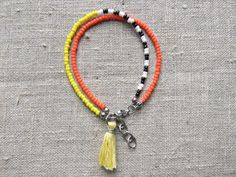 Bracelet / Armbånd. Yellow and orange bracelet made of steel and seedbeads. www.bulowssmykker55.amioamio.com