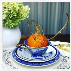 A table set with Blue Italian featuring a pop of fall! We couldn't this this more  thanks for sharing @customonlineinteriordesign #tablescapethursday