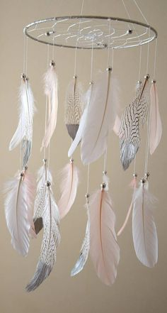 Baby Mobile, Dream Catcher Blush White Feather Mobile, Baby Girl Nursery Decor. This beautiful dream catcher mobile made of a sturdy metal ring wrapped in silver organza ribbon. Webbed with white iris cotton thread and a few silver/clear crystal beads in the web. The large snow white, blush pink goose feathers and natural color pheasant feathers with silver beads detailing. Each mobile has 20 feathers, some of the feathers hand painted in silver. Dreamcatcher ring 10 inches in diameter. ...