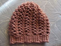 This Mama Knits: Lace Hat Pattern on a loom with directions - she recommends stitch markers