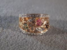 Vintage Sterling Silver  Yellow Gold Overlay Multi Round Emerald Ruby Blue Sapphire 2 Round Diamond Wedding Cigar Band Ring, Size 8. $76.00, via Etsy.