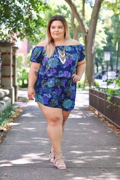 Chicago plus size fashion blogger Natalie Craig reviews City Chic's off the shoulder Plus Palm Floral Romper sold at Macy's.
