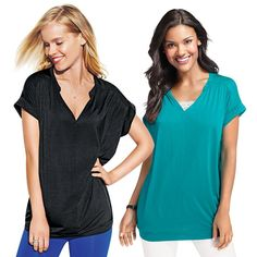 "Oversized-fit top designed to fall below the hip and combine with tanks for a cute layered look. Veatures a v-neck and short dolman sleeves.· Front: 95% Rayon, 5% Spandex· Back: 100% Polyester· Length from center back/neck: S/M – 25 1/2""; 1X/2X – 26 1/2""· Hand wash cold separately; do not use chlorine bleach· Do not twist or wring; reshape and lay flat to dry; cool iron as needed· Imported"