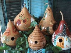 HOW TO MAKE A GOURD BIRD HOUSE  http://www.diynetwork.com/how-to/how-to-make-a-gourd-bird-house/index.html  <- Instructions here  Dried bottle gourds make the perfect bird house. This do-it-yourself project is easy and fun for the whole family.  https://www.youtube.com/watch?v=Yd-epTEwWEc  <- Video Tutorial  http://judyscottagegarden.blogspot.com/2013/09/3-easy-fun-birdhouse-weekend-project.html  <- Photo credit and more bird house tutorials