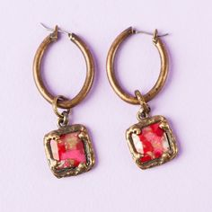Two-in-one looks are an Angel Court specialty. Wear these hoops with or without the magenta drops.