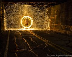 Long exposure Steel wool lit on fire spun on a leash while spinning in a circle