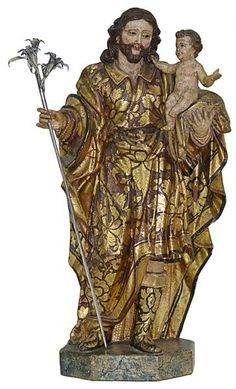 Bahia sec. XVIII. Imagem em madeira esculpida, policromada e dourada representando São José de Botas com o Menino Jesus. Apresenta-se em sua tradicional atitude com o Menino recolhido ao braço esquerdo, o outro levantado e segurando o cajado. Destacam-se ainda o movimentado e complexo panejamento das vestes com rica douração. Base retangular chanfrada. Olhos de vidro. Alt. 36 cm. Base R$6.000,00.
