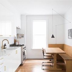 A Brooklyn kitchen by Space Exploration has basic Ikea cabinetry with glossy white cabinet fronts and marble countertops. For more, see Kitchen of the Week: An Ikea Kitchen with an Elegant Upper Cabinet Solution. Kitchen On A Budget, New Kitchen, Kitchen Nook, Crisp Kitchen, Kitchen Ideas, Funny Kitchen, Kitchen Trends, Wooden Kitchen, Ikea Ringhult