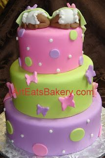 Three tier pink, green, and purple fondant butterflies and polka dots twins baby shower cake