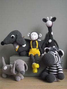 ФОТО.Adorable handmade toys - knitted animals in dark, light grey, white & yellow. I could easily start collect & never get enough.It's the simple shape & uncomplicated style that makes the...
