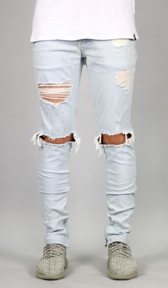 FIT : SLIM TAPERED LEG If you are looking for a looser fit we suggest one size up - Stretch denim for increased wearability - Destroyed details and ripped knee - Zipper on side ankles - Five pocket st