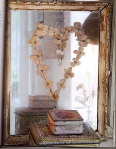 Oh how I adore this pale hued, shabby chic Valentine's Day decor. #heart #shabby #chic #decor #decorations #mirror #home #romantic