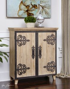 rustic wood console with wrought iron detail