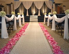 I would want the church decorate similarly to this. I love the flower petals lining the aisles and the draping.
