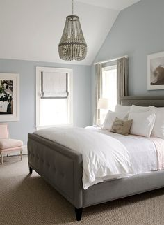 Grey headboard, white bedding, blue walls