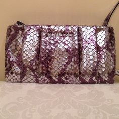 Michael Kors clutch. NWOT Michael Kors silver snakeskin print pleated clutch. Genuine leather. Has removable shoulder strap. Silver hardware. Inside has a zippered compartment with 6 credit card slots and one open pocket. This bag is new but without tags. Never used. No dust bag Michael Kors Bags Clutches & Wristlets