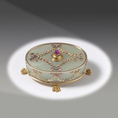 A Carved Bowenite, Gold and Gem-Set Bellpush by Carl Faberge - retailed by Tiffany & Co.