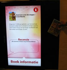 Bibliotheek Floriande, Hoofddorp - The new library offers a number of interesting integrations of the virtual at the physical library, as e.g. in the picture, an RFID-based book scanner, where visitors at the library can pull any title they like across the screen and activate background data and any reviews submitted by other users