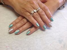 Aqua with silver glitter accent nail and flower design  Oasis Salon and Spa Mill Hall Pa (570)726-6565