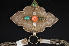 Old Tibetan belt buckle with chain, decorated with a central coral and 3 turquoise cabochons. It has also a very beautiful filigree and granulation. On the chain part some stones are missing, probably turquoise.19° to early 20° century. This is an exceptional collection piece. Price: on request. For more information, please email me at didiergregoire03@gmail.comGalery-detail